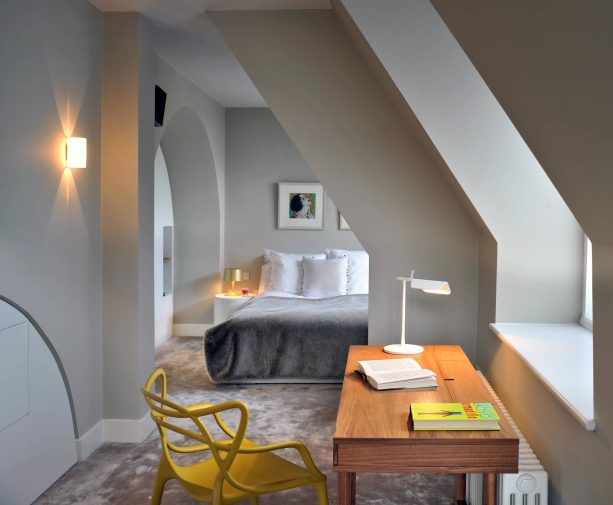 beige carpet color goes with light gray walls for narrow bedroom