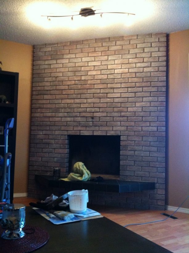 black standard modern fireplace with wall-size gray-washed brick fireplace mantel