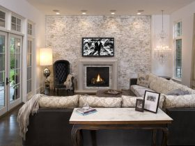chic living room design with white and gray-washed accent brick wall