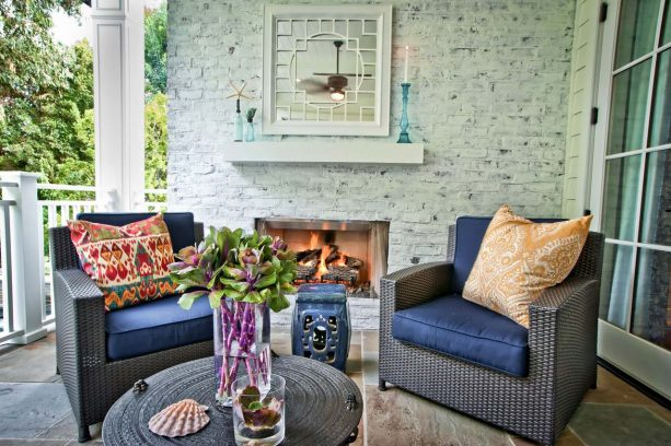 contemporary patio with grayish color-washed accent brick wall