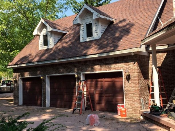 home exterior look with red brick walls and penny brown doors before color-washing process