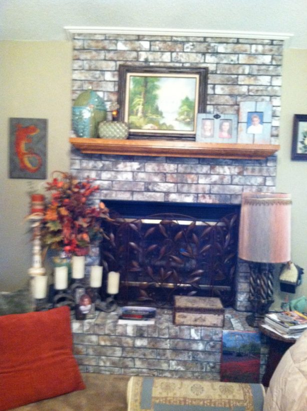 after makeover floor to ceiling grayish brick fireplace