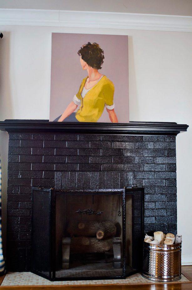 black brick fireplace with black mantel shelf