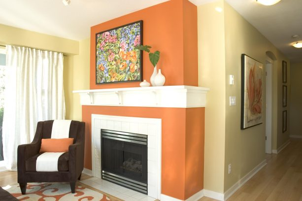 contemporary living room with white interior trim, Benjamin Moore Adams Gold HC-18 wall color and Benjamin Moore Racing Orange 2169-10 fireplace wall color combinations
