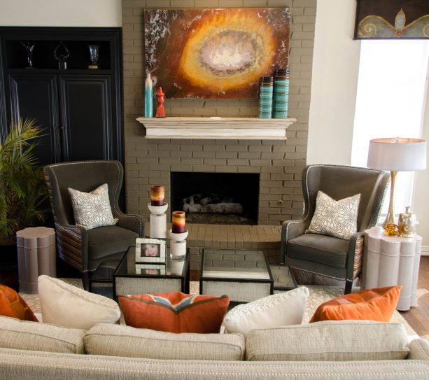 eclectic family room with tall greige brick fireplace