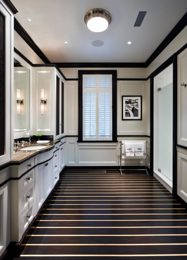 traditional bathroom design with white glass shower room door and black interior trim paint color