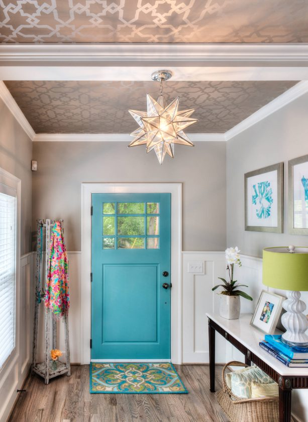 traditional entry with sapphire blue wall and white trim paint color