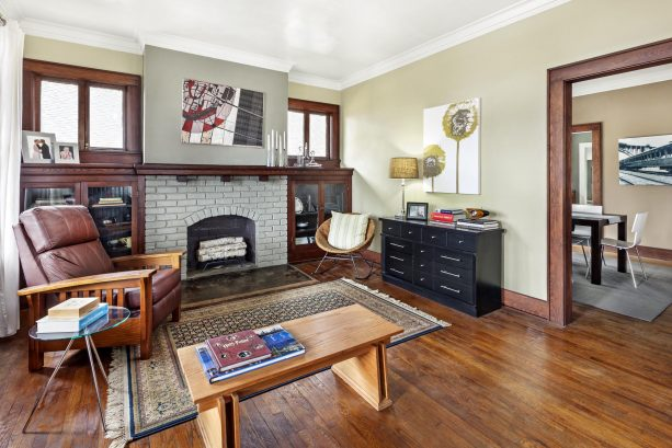 transitional living room with gray painted brick fireplace