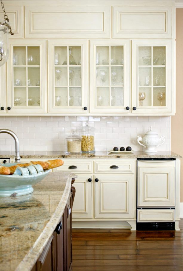 kitchen with antique white cabinets and white subway tile backsplash