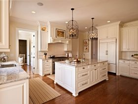 traditional kitchen with antique white cabinets and medium tone hardwood flooring