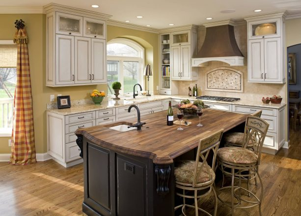 traditional kitchen with antique white cabinets with chocolate glaze