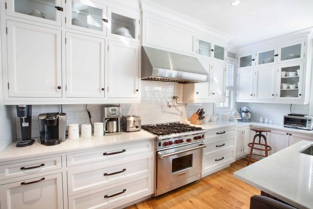 transitional kitchen with antique white cabinets and bronze metal hardware