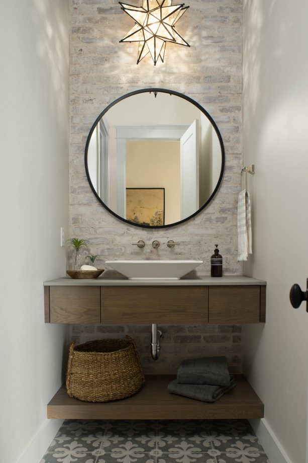 after photo of a powder room with german smear brick wall