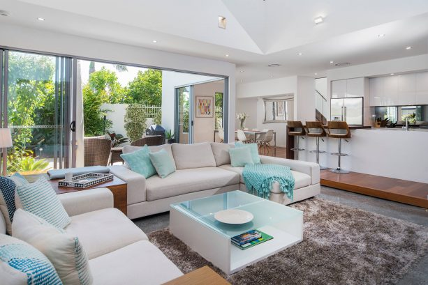 grey and blue beach-style living room with green view
