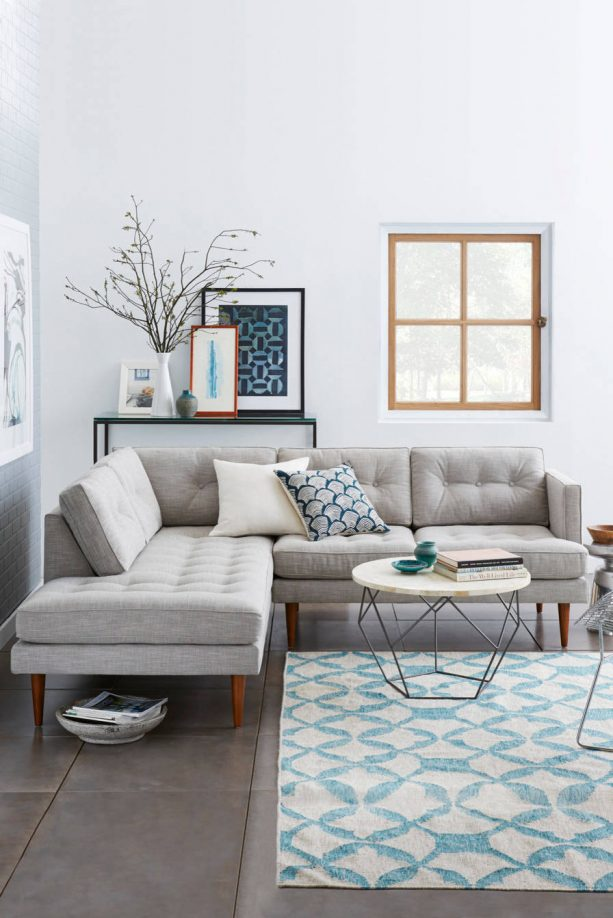grey and blue living room with white background wall