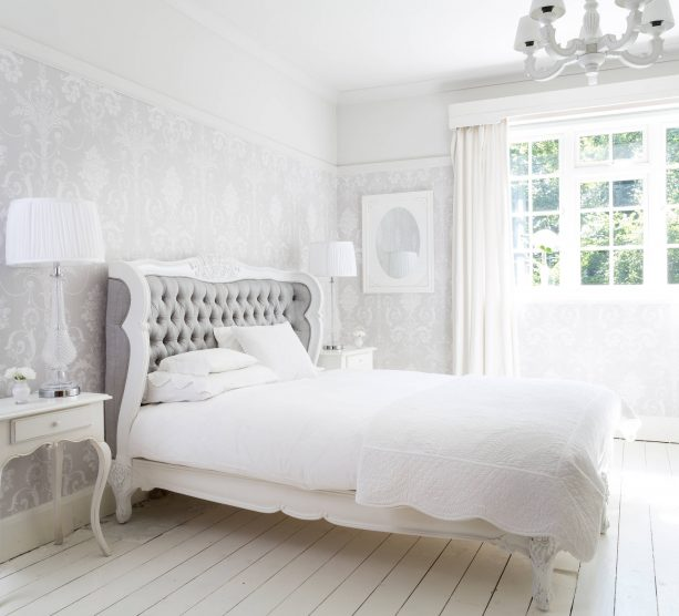 grey and white bedroom with white hardwood floor