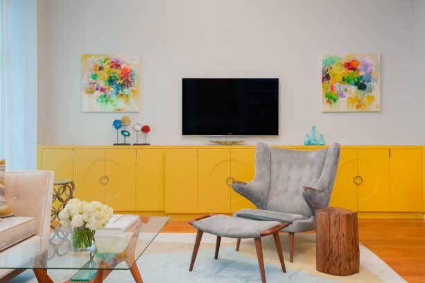 grey and yellow living room with custom canary yellow cabinets