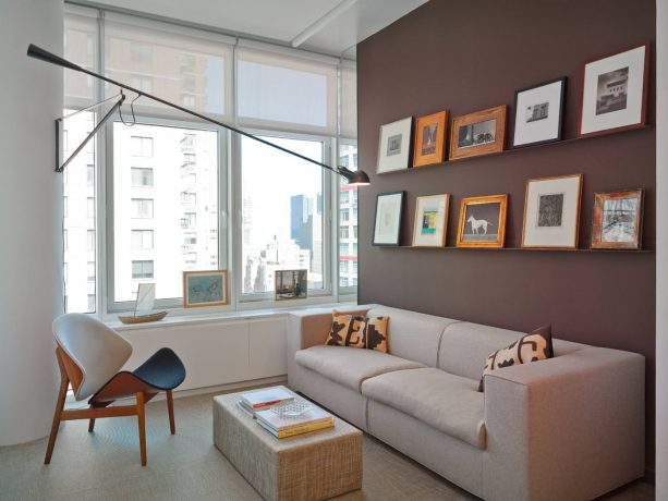 grey and brown living room with chocolate accent wall