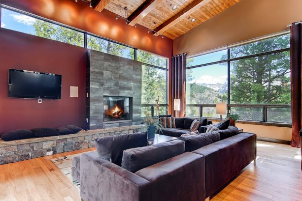 grey and brown living room with stone elements