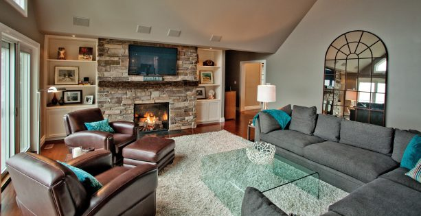 grey and brown living room with teal accents
