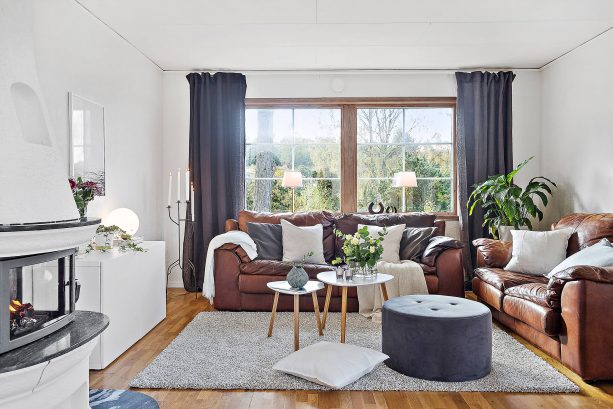 grey and brown living room with two bulky leather sofas