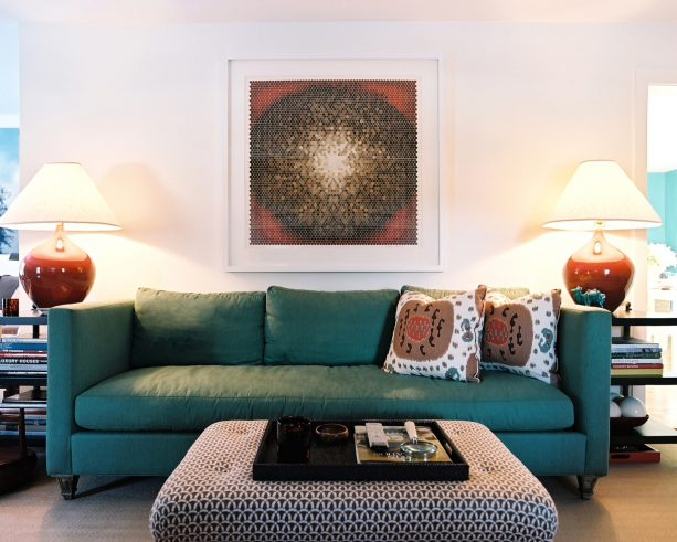 grey and teal living room with red accents