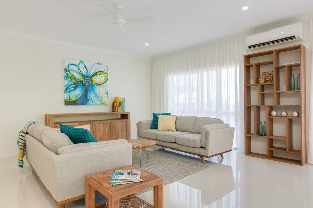 grey and teal living room with unfinished wooden furniture pieces