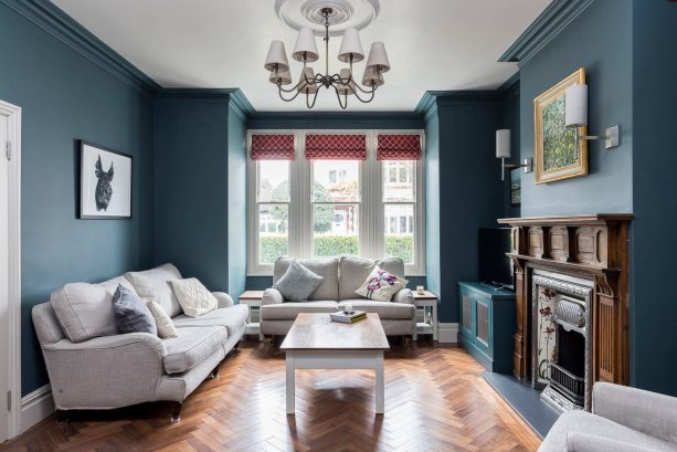 grey living room with a dark teal wall
