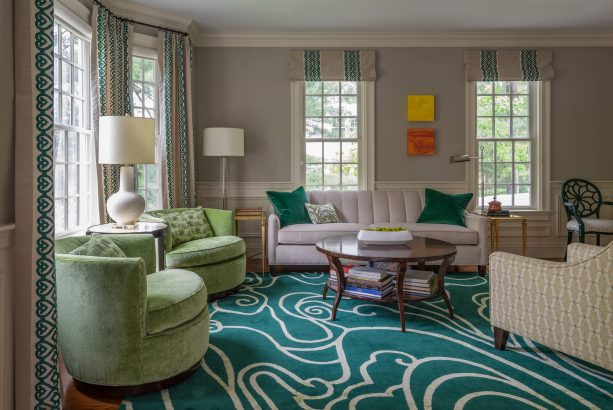 grey living room with abstract teal carpet