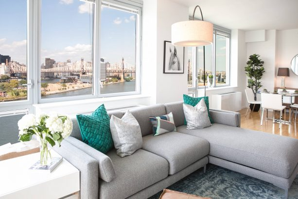 grey sectional living room couch with teal pillows