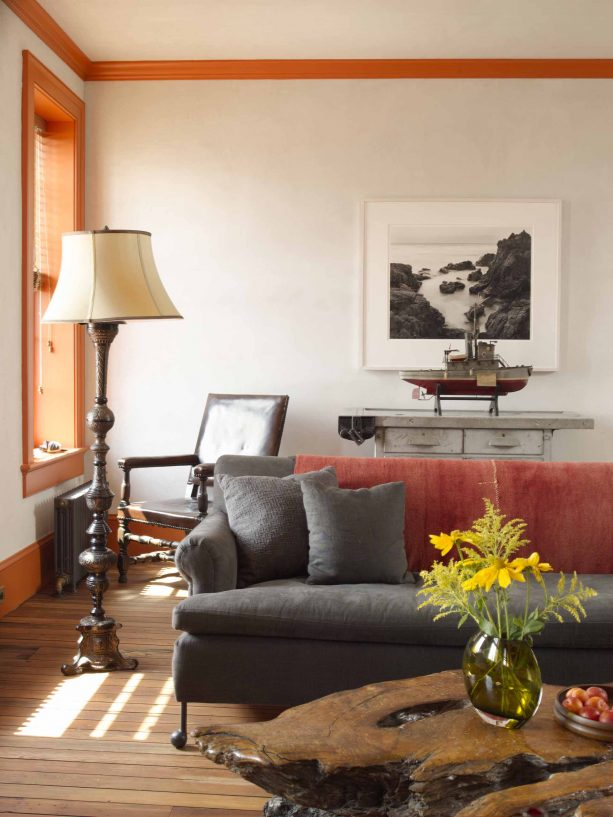 living room with grey, brown and orange color scheme