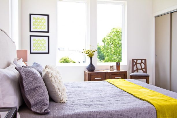 airy grey and yellow bedroom
