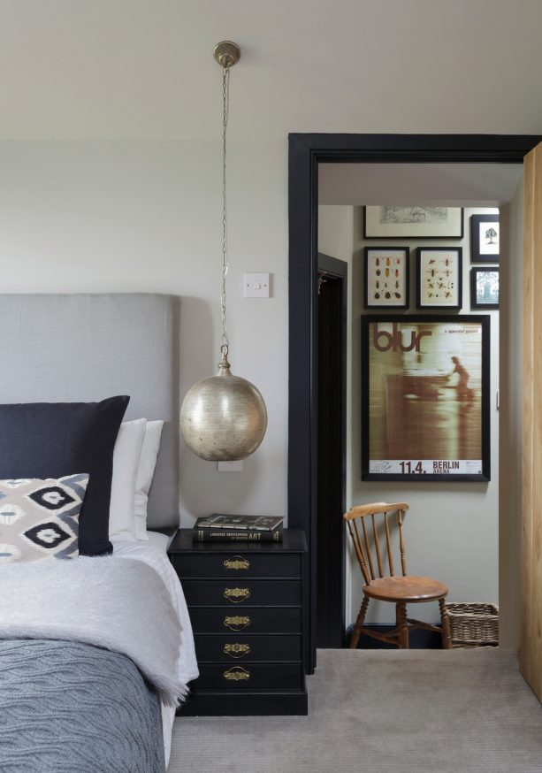 blue and grey bedroom with black trim