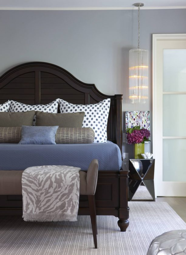 blue and grey bedroom with brown king size wooden bed