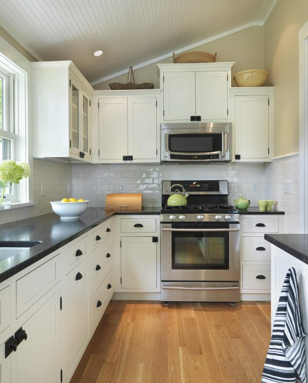 cream cabinets with honed black granite countertops with leather finish