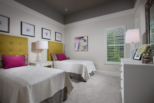 grey and yellow bedroom with pink pillows