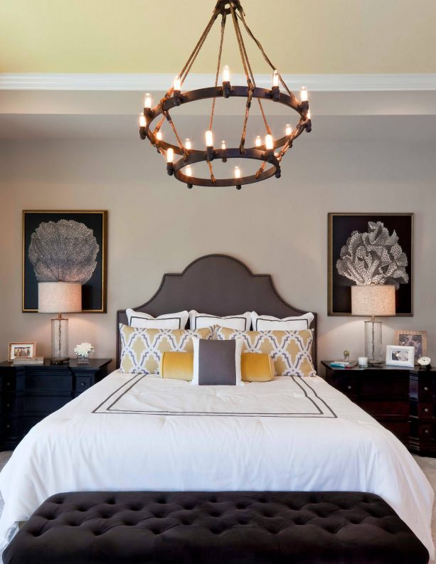 grey and yellow bedroom with traditional style chandelier