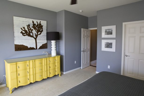 grey bedroom with custom yellow dresser