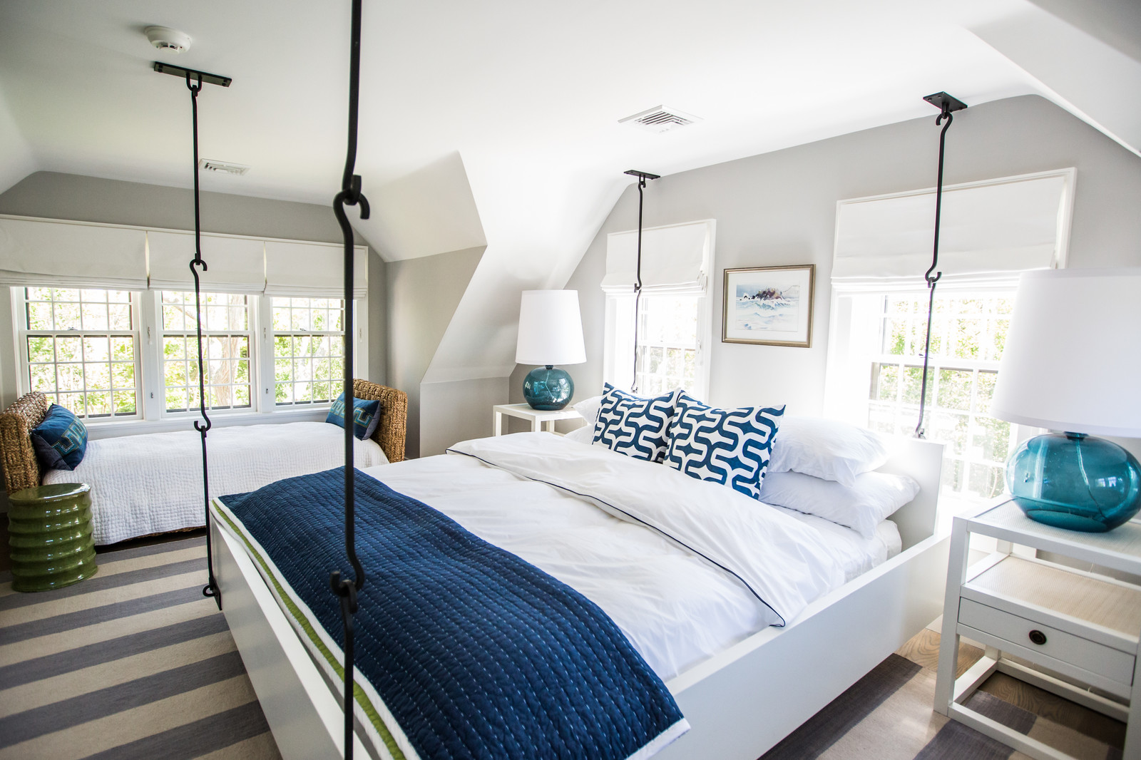 light grey bedroom with navy pillows and blanket