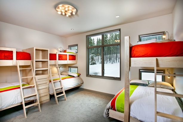bedroom with light gray walls and red-white-lime green bedding set