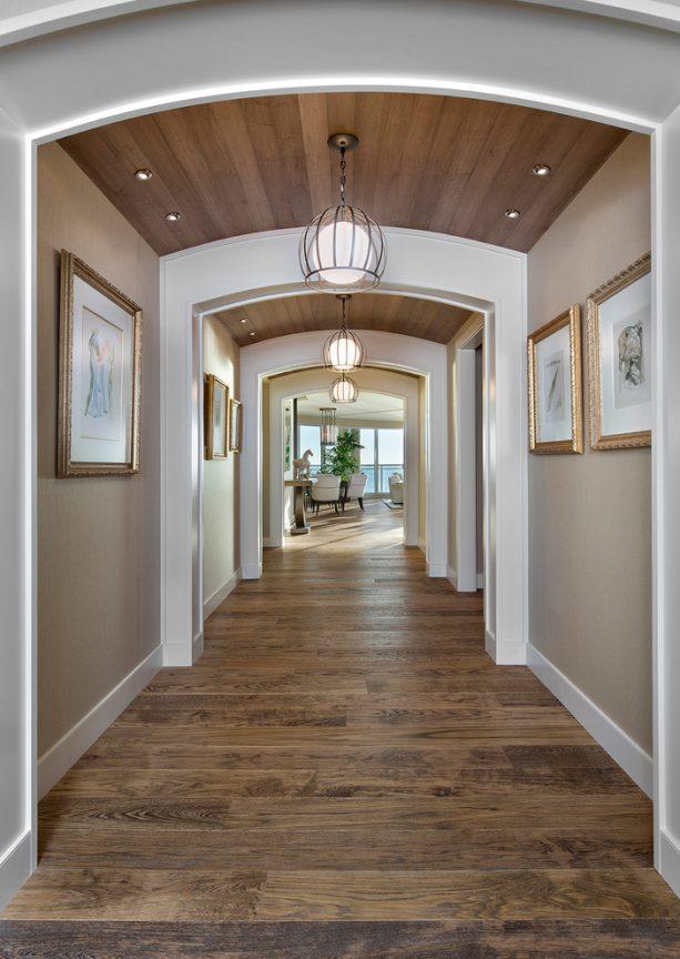beige hallway with archways feature