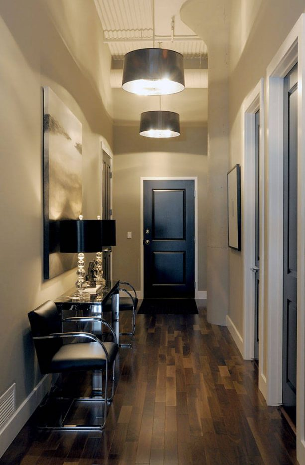 beige hallway with black doors and white trim