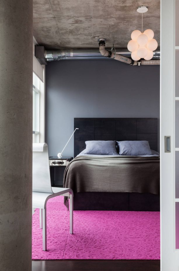 contemporary grey bedroom with pink area rug