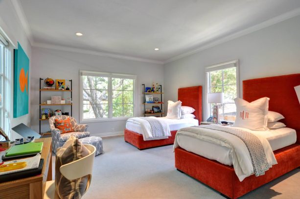 gray-dominated bedroom with red beds