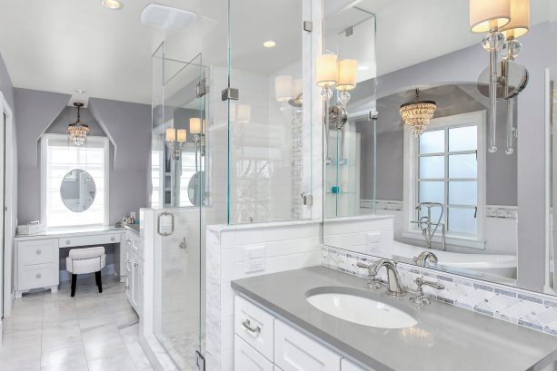 grey and white bathroom with grey quartz countertops