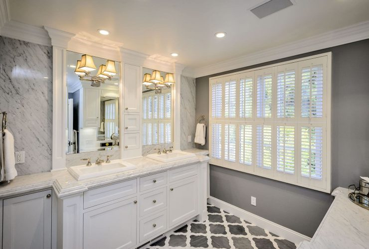 grey and white bathroom with patterned tile flooring