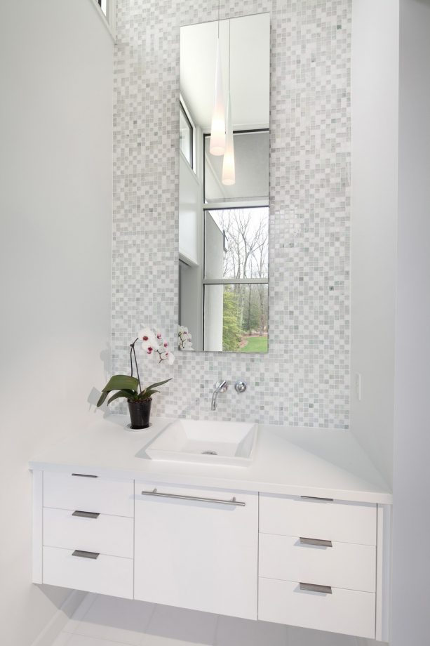 grey and white bathroom with tall mirror