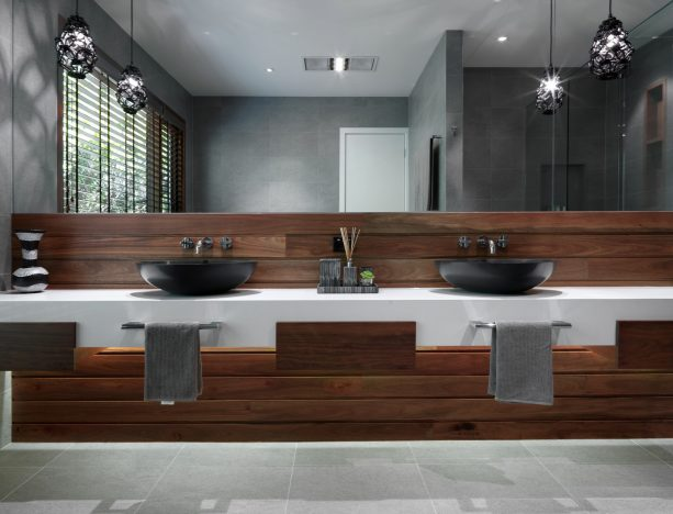 grey and white bathroom with wood panels for the sink area