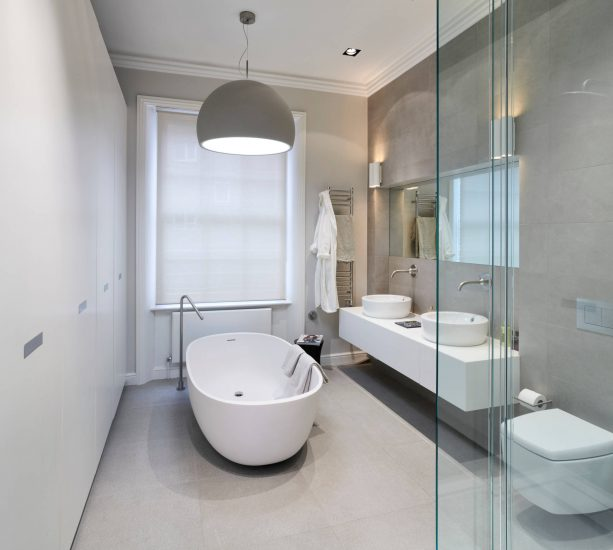 grey and white contemporary bathroom with bowl-style tub