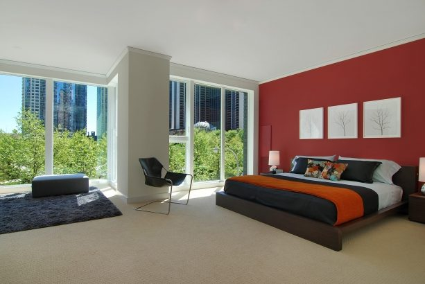 grey bedroom with deep red accent wall
